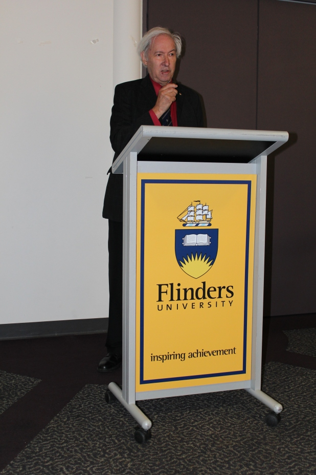 Emeritus Professor Vincent Megaw, the first Honorary Life Member of of the Flinders ArchSoc, congratulates the graduates while explaining how he came to set up the Archaeology Department at Flinders. Photograph: Jordan Ralph, April 2013.