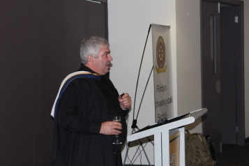 Flinders ArchSoc President, Andrew Wilkinson raises a toast to the families, friends and staff that have supported the new graduates throughout their degrees. Photograph: Jordan Ralph, April 2013.